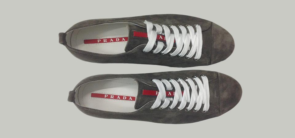 In passerella le calzature Prada uomo della Primavera Estate 2013 si  snodavano fra modelli casual-sport 5a78e0ca234